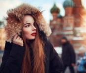 A beautiful girl wearing jacket & red lipstic walking on street