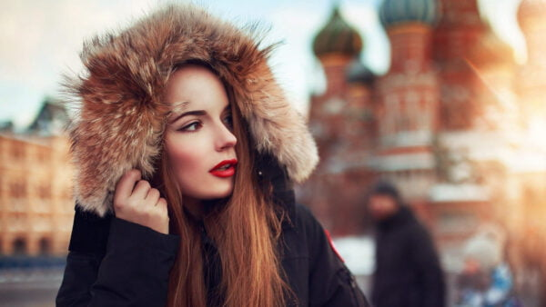 A beautiful girl wearing jacket & red lipstic walking on street